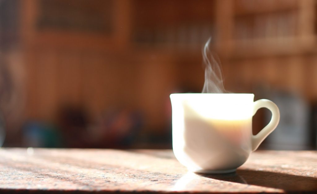 coffee cup steaming in the morning light.