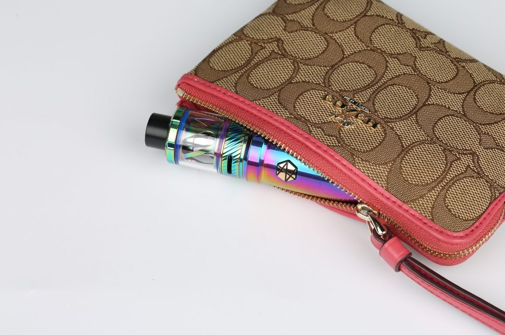 vape pen sticking out of purse